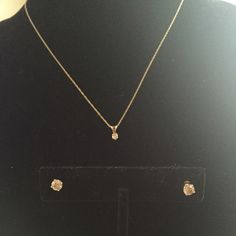 14k gold & diamond earrings & necklace set Dainty real 14k gold and over 1/4 carat diamond. Really pretty set just need a little cleaning. Trade value $600 Jewelry