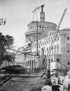 The US capitol building in Washington DC, under construction. 1861.