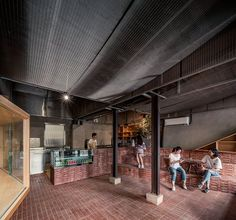 Completed in 2018 in Beijing, China. Images by Weiqi Jin. Beijing-based architecture studio, TEMP has designed a café in the old hutong area near the Drum Tower, Beijng. Café Parallel occupies an old wood. Brick Cafe, Starting A Restaurant, Chinese Courtyard, Brick Interior, Pub Interior, Modern Cafe, Built In Furniture, Outdoor Restaurant, Brick Design