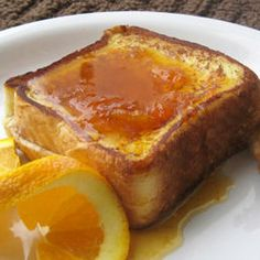 Pecan Cream Cheese Stuffed French Toast with Almond Citrus Syrup via Hostess with the Mostess
