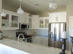 perfect! i love the wall color with the white cabinets and backsplash!