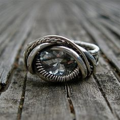 Sterling Silver wire wrapped Blue Topaz ring by MineralSynergy