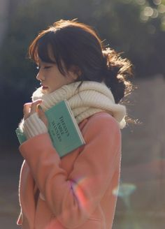 Light pink peacoat with a white sweater and a cream colored scarf