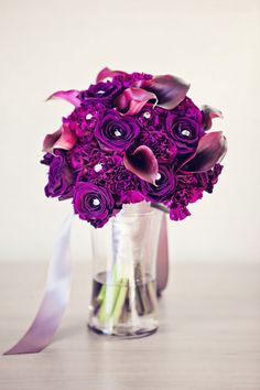 The perfect hues of deep purple!  Floral by Primrose Lane Flowers. Photograph by Moxie Studio  http://www.storyboardwedding.com/vintage-glam-at-the-height-of-the-las-vegas-strip-clad-in-deep-purples-soft-greys/