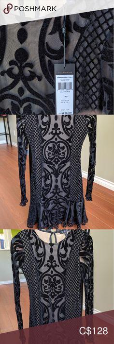 BCBG dress Super cute black BCBG dress. It's short with long sleeves. The black part is felt-like. Brand new XS. BCBGMaxAzria Dresses Long Sleeve