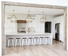 **LOve the beams in the arch. and also like the walled in hood range.