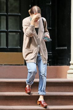 Ashley Olsen in an oversized cardigan and boyfriend jeans