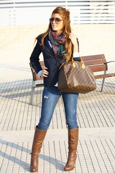 Business casual work outfit: navy blazer, white tee, denim skinnies, colorful scarf & brown boots.