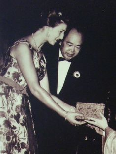 During her visit to Hong Kong in 1961, Princess Alexandra greets Cantonese opera performers Yam Kim-fai and Bak Sheut-sin after their performance of The Romance of the White Snake
