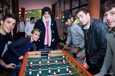 Students playing #footzy #foosball, though table soccer, in front of Atale (student residence). Photo @Hotsoft & Pierre Chevalier