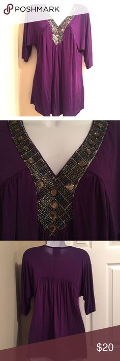 Beautiful Purple Blouse This beautiful purple blouse has detailing around the v-neck that's a mixture of emerald green and purple. It's in excellent pre-loved condition. 95% Rayon, 5% Spandex Tops Blouses