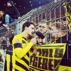Mats Hummels talks with Dortmund fans following a defeat, leaving them at the bottom of the table. February 2015