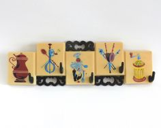 Vintage Kitchen Towel Rack, Potholder Hooks, Vintage Plastic Utensil Holder by GrouchyParrot on Etsy https://www.etsy.com/listing/218378078/vintage-kitchen-towel-rack-potholder