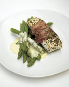 delicious roasted white fish wrapped in smoked bacon with lemon mayonnaise and aspara