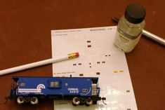 Tired of multiple train cars or locomotives with the same number? Learn how to change the numbers on decorated models. Model Training, Pencil Eraser, Peeling Paint, Learning Numbers, Model Train Layouts, Train Car, Paint Schemes, Models, Classic Toys