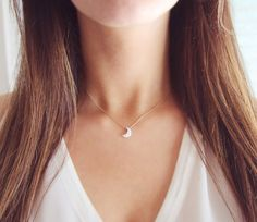 Tiny crescent moon necklace by Amanda Deer Jewelry. Opal moon charm threaded along a dainty gold chain. #crescentmoon