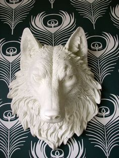 This is badass and I feel like we need it for our new home LOL.....Faux Taxidermy Full Size Wolf Head Wall Decor by mahzerandvee,