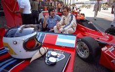 Brabham designer Gordon Murray chats with Carlos Reutemann, sitting on the Brabham BT45 at Long Beach,1976