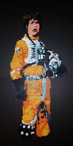 "Star Wars Luke Skywalker in Rebel flight suit made with 7,452 Perler Beads. About 15 x 32.5"". By BeecherCrafts"