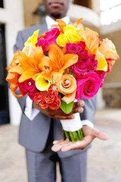 i would like my groom to hand me my bouquet blindfolded...that way he can't see me, but i can get out those first jitters of seeing him...!!!