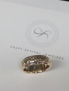 Hammer effect done on a gents wedding band from Craft-Revival Jewelers