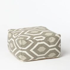 two poufs stored under the coffee table(s) for added seating, kids play and a punch of pattern.