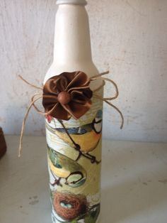 Esta garrafa foi produzida pelas artesãs do Projeto Reciclarte, desenvolvido em parceria com a ONG Fazendo Arte - RJ