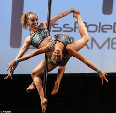 "Pole dancing athletes travel to Buenos Aires, Argentina to compete in the Miss Pole Dance South America Competition. ""Tallyta Torres and Ekaterina Malykhina of Brazil perform during the doubles category at the Miss Pole Dance South American 2013 competition."""