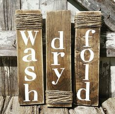 Wash Dry Fold sign set! These signs are a must for all the rustic laundry rooms. Each sign is roughly 4x13 and come ready to hang. Stained with distressed sides. This is painted with non toxic acrylic. Rustic jute rope is wrapped on each sign. This listing is for 3 signs - Wash, Dry, Fold PLEASE NOTE: Each sign is hand cut and size may vary ever so slightly :) Our signs start with the design process. All of our creations are designed and made by us, hand-cut and stained! We dont use…
