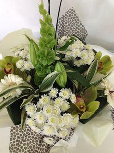 The Animal Instinct- floral gift bag https://www.taylerjamesflowers.com/design/animal-instinct.htm