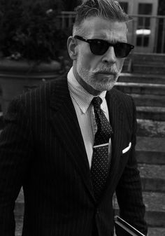 It all works. Like that haircut, the shades....a tie clip! Nick Wooster rocks a tie clip.