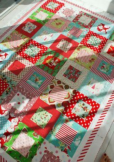 PJL's christmas quilt love the red stripe border.  This looks nice and simple.