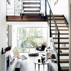 Nice use of space and light.  I'm not crazy about the modern furniture, but that can be changed.