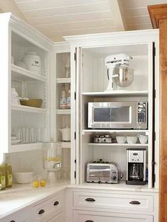 Small appliance storage on the counter height shelf...extra outlets.