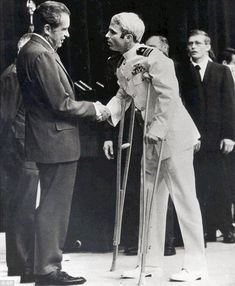 John McCain, recently released after 5 years in Hanoi Hilton, meets Pres. Nixon in 1973. On May 24 of that year, Nixon had a huge White House gala to celebrate the homecoming of the POWs.