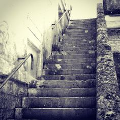 Walking up the stairs but never looking back to what you left behind.