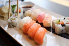 - could place chopsticks elsewhere, otherwise good use for reminding the sushi is meant to be eaten! - shallow depth of focus - soft colors