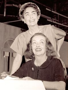 """Joan Crawford & Bette Davis """"She has slept  with every male star at MGM except Lassie"""" Bette said of Joan."""