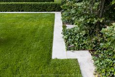 Flush stone edging between a planting bed and grass.