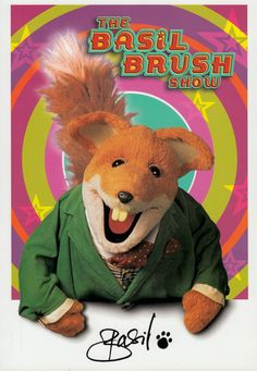 BASIL BRUSH SHOW (1962-now) Ist voiced & performed by unseen Ivan Owen ('62-2000) in a voice like Terry Thomas.  As well as his TV show with various presenters, Basil appears annually in British Christmas pantomimes, on chat shows & guests on TV shows, & has his own comic strip. A Corgi Basil Brush car ('71) & puppet toys were released.  In 2015 The Basil Brush Show was launched on youtube, with a new sketch every Monday over 37 weeks. Catch phrase 'Boom Boom'. 2003 Toy Show p/c…
