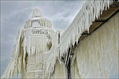 Frozen lighthouses on Lake Michigan: Lighthouses covered in ice captured by photographer Tom Gill - wptv.com