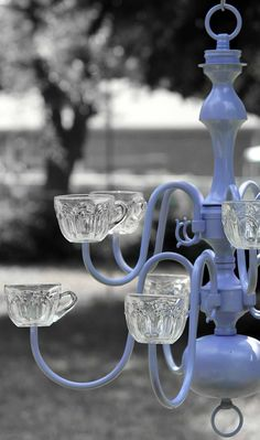 Planter/Chandelier - this would be very pretty hanging in a screened sun porch with votive candles for evening lighting.