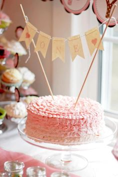 """1st birthday cake? home made-organic-minimal sugar-chocolate and vanilla cake? learn decorative frosting """"ONE"""" bunting cake topper"""