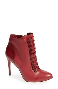 "Free shipping and returns on BCBGMAXAZRIA 'Bari' Bootie (Women) at Nordstrom.com. <p><B STYLE=""COLOR:#990000"">Pre-order this style today! Add to Shopping Bag to view approximate ship date. You'll be charged only when your item ships.</b></p><br>Lizard-embossed paneling lends subtle, exotic allure to a stunning calfskin bootie lifted by a tall, slim heel."