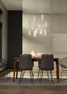 The Mini-Signal pendant lights by LBL Lighting are inspired by vintage automobile styling of the 1940s. Spun metal shades with rubberized paint create a flawlessly smooth look that also offers an unexpected metallic texture and color.