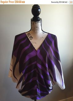 Gorgeous Silk Blouse! The tag says size Small but it could easily be Medium and potentially Large but please see measurements.  Condition: