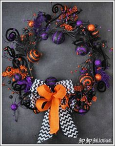 Whimsical Halloween Wreath - This is a fun whimsical wreath that I think even Tim Burton would be proud of! Nothing says Halloween like the c…