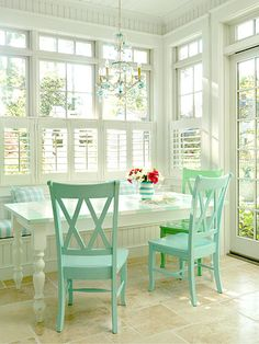 Pretty breakfast nook. I love the colors, all the windows, and the chandelier