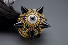 Feather Comet Eyeball Mace (detail)