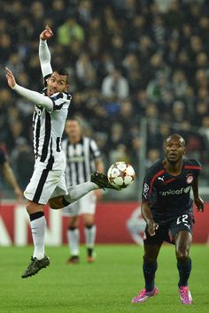 Juventus 3 Olympiakos 2 in Nov 2014 at Juventus Arena. Carl Tevez and Eric Abidal in action in the Champions League, Group A, clash.